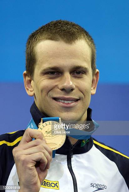 Cesar Cielo Filho of Brazil celebrates winning the gold medal in the Men's 50m Freestyle Final during Day Fifteen of the 14th FINA World...