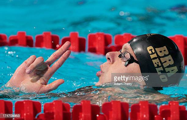 Cesar Cielo Filho of Brazil celebrates winning the Swimming Men's 50m Butterfly Semifinal 1 on day nine of the 15th FINA World Championships at Palau...