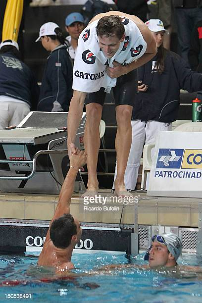Cesar Cielo from Brazil celebrates the victory with your teammate during the Jose Finkel Trophy of swimming at SESI Vila Leopoldina pool on Aug 20...