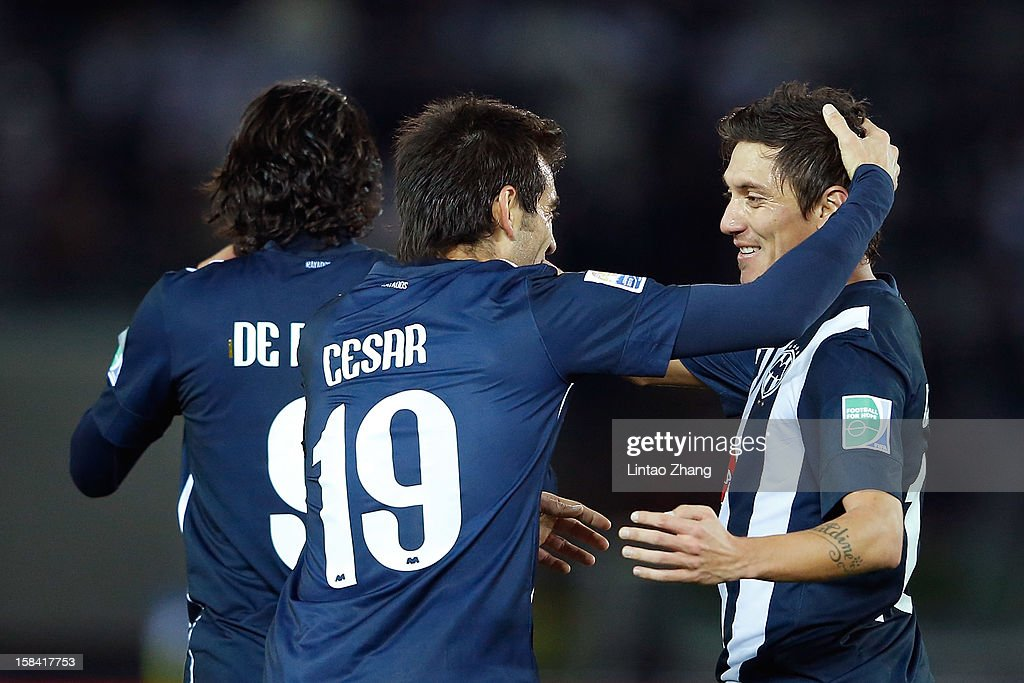 <a gi-track='captionPersonalityLinkClicked' href=/galleries/search?phrase=Cesar+Delgado&family=editorial&specificpeople=675597 ng-click='$event.stopPropagation()'>Cesar Delgado</a> (C) elebrates scoring their first goal with Aldo De Nigris (L) and Elsayed Hamdi of CF Monterrey during the FIFA Club World Cup 3rd Place Match between Al-Ahly SC and CF Monterrey at International Stadium Yokohama on December 16, 2012 in Yokohama, Japan.