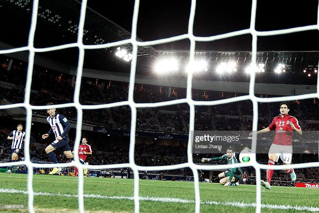 <a gi-track='captionPersonalityLinkClicked' href=/galleries/search?phrase=Cesar+Delgado&family=editorial&specificpeople=675597 ng-click='$event.stopPropagation()'>Cesar Delgado</a> (L) of Monterrey celebrates scoring to make it 2-0 during the FIFA Club World Cup 3rd Place Match between Al-Ahly SC and CF Monterrey at International Stadium Yokohama on December 16, 2012 in Yokohama, Japan.