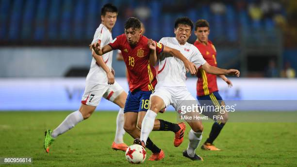 Cesar Gelabert of Spain battles with Kim Chung Jin of Korea DPR during the FIFA U17 World Cup India 2017 group D match between Spain and Korea DPR at...