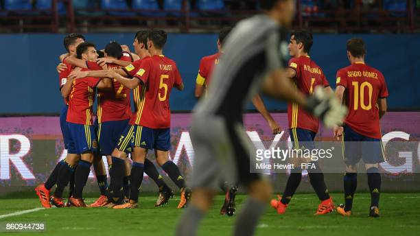 Cesar Gelabert of Spain is mobbed byteam mates after scoring his team's 2nd goal during the FIFA U17 World Cup India 2017 group D match between Spain...