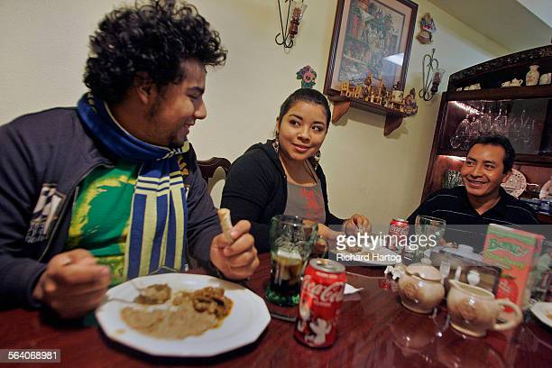 Cesar Gomez left and his family have dinner at home in Los Angeles Friday January 12 2007 His father Felipe is seated at right His sister Thania is...