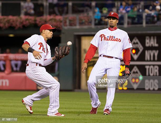 Cesar Hernandez of the Philadelphia Phillies bobbles the ball but makes the catch in front of Aaron Altherr in the top of the eighth inning against...