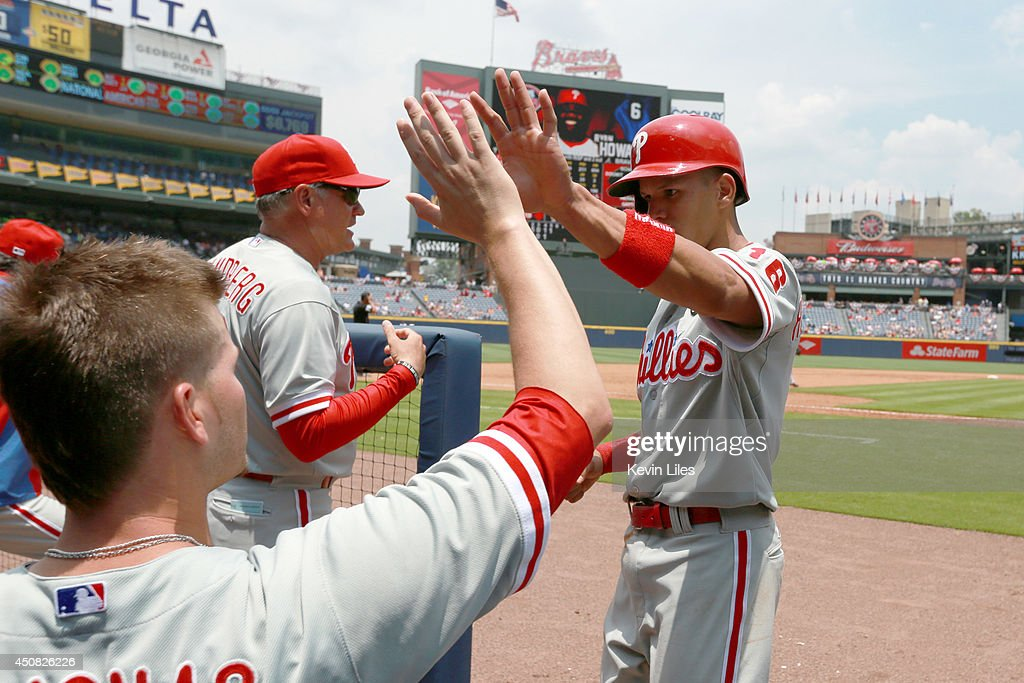 Cesar Hernandez #16 of the Philadelphia Phillies celebrates scoring against the Atlanta Braves during the fifth inning at Turner Field on June 18, 2014 in Atlanta, Georgia. The Braves won 10-5.