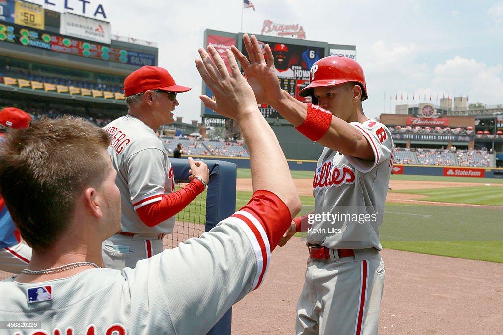 Cesar Hernandez #16 of the Philadelphia Phillies celebrates scoring against the Atlanta Braves during the fifth inning at Turner Field on June 18, 2014 in Atlanta, Georgia. The Braves won 10-5.