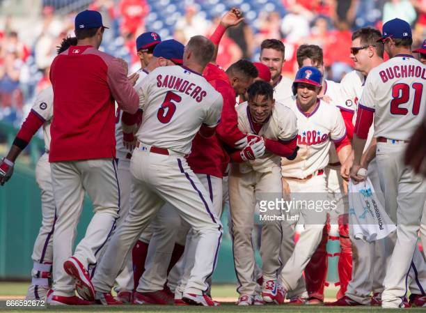 Cesar Hernandez of the Philadelphia Phillies celebrates with Andres Blanco Michael Saunders Daniel Nava and the rest of the team after hitting a walk...