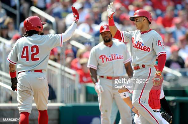 Cesar Hernandez of the Philadelphia Phillies celebrates with Freddy Galvis after hitting the game winning home run in the eighth inning against the...