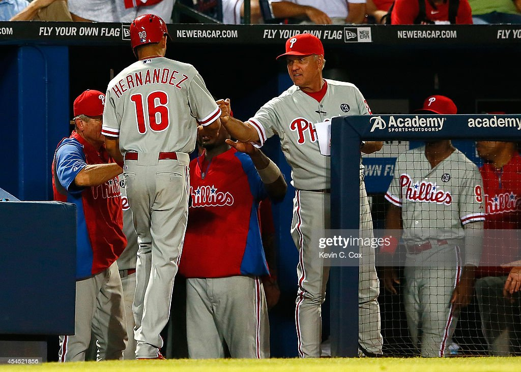 Cesar Hernandez #16 of the Philadelphia Phillies celebrates with manager <a gi-track='captionPersonalityLinkClicked' href=/galleries/search?phrase=Ryne+Sandberg&family=editorial&specificpeople=206643 ng-click='$event.stopPropagation()'>Ryne Sandberg</a> #23 after scoring off a RBI double by Carlos Ruiz #51 in the eighth inning against the Atlanta Braves at Turner Field on September 2, 2014 in Atlanta, Georgia.
