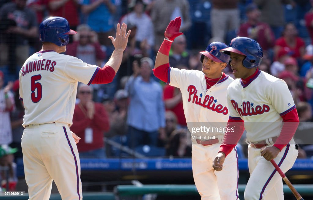 Cesar Hernandez #16 of the Philadelphia Phillies celebrates with Michael Saunders #5 after hitting a two run home run in the bottom of the eighth inning against the Atlanta Braves at Citizens Bank Park on April 23, 2017 in Philadelphia, Pennsylvania. The Phillies defeated the Braves 5-2.