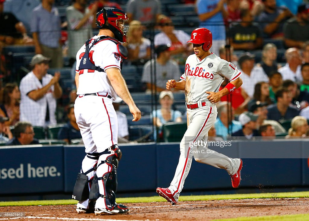 Cesar Hernandez #16 of the Philadelphia Phillies heads home on a RBI double by Carlos Ruiz #51 in the eighth inning against the Atlanta Braves at Turner Field on September 2, 2014 in Atlanta, Georgia.