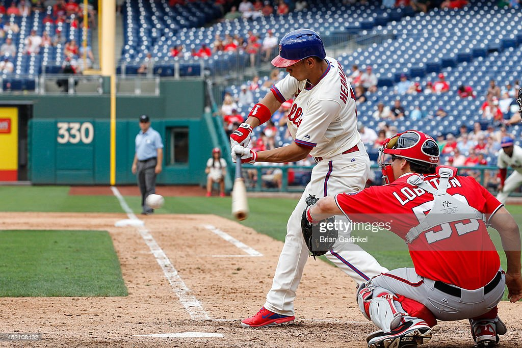 Cesar Hernandez #16 of the Philadelphia Phillies hits a single in the ninth inning of the game against the Washington Nationals at Citizens Bank Park on July 13, 2014 in Philadelphia, Pennsylvania. The Nationals won 10-3.