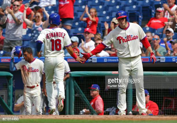 Cesar Hernandez of the Philadelphia Phillies is congratulated at home plate by Jerad Eickhoff after scoring a run in the fifth inning during a game...