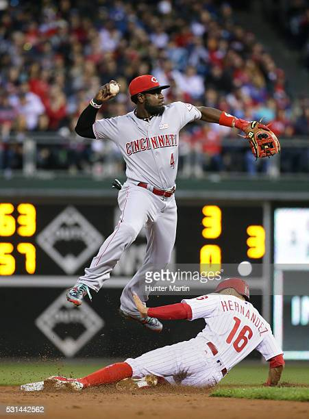 Cesar Hernandez of the Philadelphia Phillies is out at second base as Brandon Phillips of the Cincinnati Reds turns a doubleplay in the first inning...