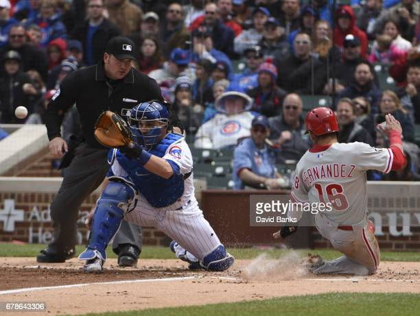 Cesar Hernandez of the Philadelphia Phillies is sade at home as Miguel Montero of the Chicago Cubs makes a late tag during the third inning on May 4...