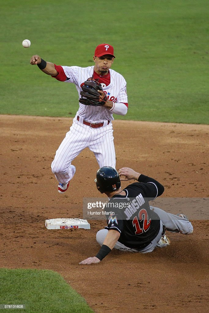Cesar Hernandez #16 of the Philadelphia Phillies turns a double play as Chris Johnson #12 of the Miami Marlins slides into second base in the third inning during a game at Citizens Bank Park on July 20, 2016 in Philadelphia, Pennsylvania.