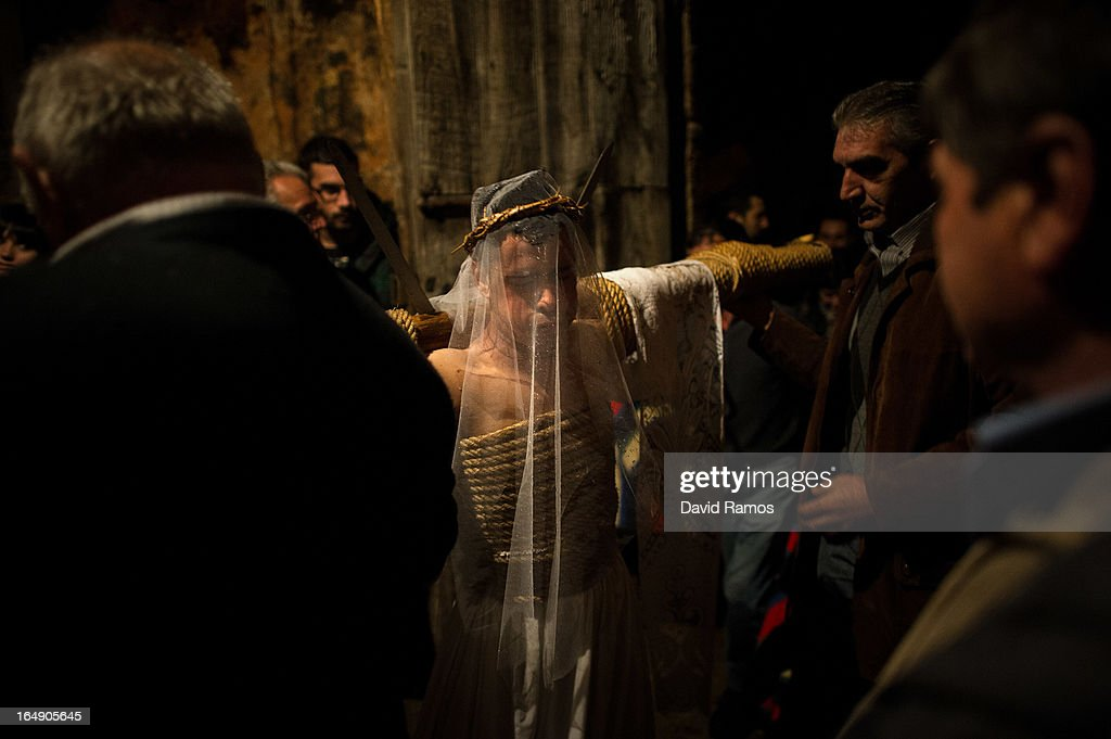 Cesar Higuero Martin, aged 25, enters a corral after he walked the way of the cross or 'Via Crucis' at the end of the procession of the 'Empalaos' on March 29, 2013 in Valverde de la Vera, Spain. Empalaos make the steps of the 'Via Crucis', marking the Stations of the Cross, during the night of Maundy Thursday while bound by rope to a crucifix as an act of penance and to honour a promise made to the Empalaos Brotherhood and the Christ of Vera Cruz, in the town of Valverde de la Vera. The process of dressing the Empalao in the traditional costume is taken with great care, with the family and dressers paying attention to ensure that no harm is caused to the penitent and that they are aided in their recovery, including being massaged and rubbed with rosemary alcohol. Many Spanish towns and villages retain such rites and religious traditions, many passed down from medieval times, across the Easter weekend.