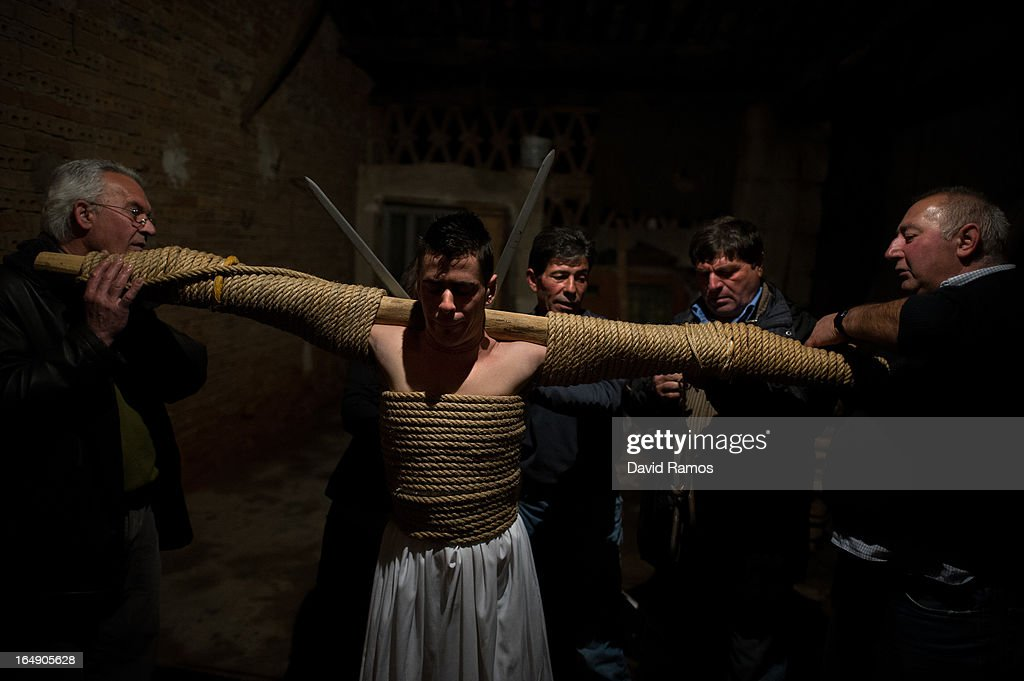 Cesar Higuero Martin, aged 25, is dressed up by relatives before walking the way of the cross or 'Via Crucis' at the end of the procession of the 'Empalaos' on March 29, 2013 in Valverde de la Vera, Spain. Empalaos make the steps of the 'Via Crucis', marking the Stations of the Cross, during the night of Maundy Thursday while bound by rope to a crucifix as an act of penance and to honour a promise made to the Empalaos Brotherhood and the Christ of Vera Cruz, in the town of Valverde de la Vera. The process of dressing the Empalao in the traditional costume is taken with great care, with the family and dressers paying attention to ensure that no harm is caused to the penitent and that they are aided in their recovery, including being massaged and rubbed with rosemary alcohol. Many Spanish towns and villages retain such rites and religious traditions, many passed down from medieval times, across the Easter weekend.