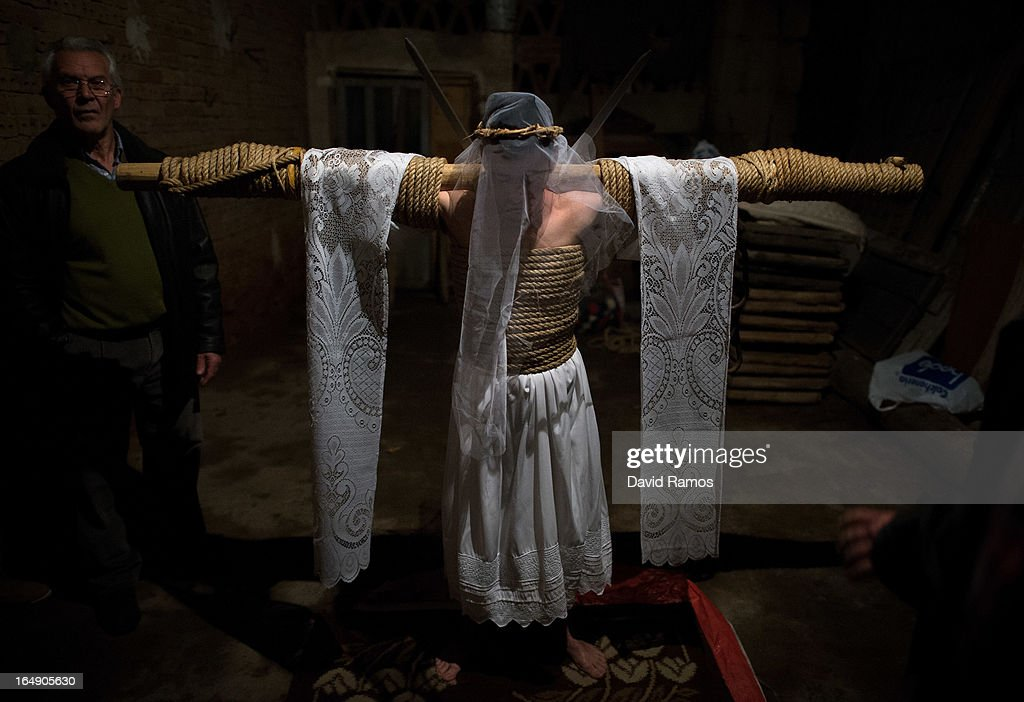 Cesar Higuero Martin, aged 25, prays at a corral before walking the way of the cross or 'Via Crucis' at the end of the procession of the 'Empalaos' on March 29, 2013 in Valverde de la Vera, Spain. Empalaos make the steps of the 'Via Crucis', marking the Stations of the Cross, during the night of Maundy Thursday while bound by rope to a crucifix as an act of penance and to honour a promise made to the Empalaos Brotherhood and the Christ of Vera Cruz, in the town of Valverde de la Vera. The process of dressing the Empalao in the traditional costume is taken with great care, with the family and dressers paying attention to ensure that no harm is caused to the penitent and that they are aided in their recovery, including being massaged and rubbed with rosemary alcohol. Many Spanish towns and villages retain such rites and religious traditions, many passed down from medieval times, across the Easter weekend.