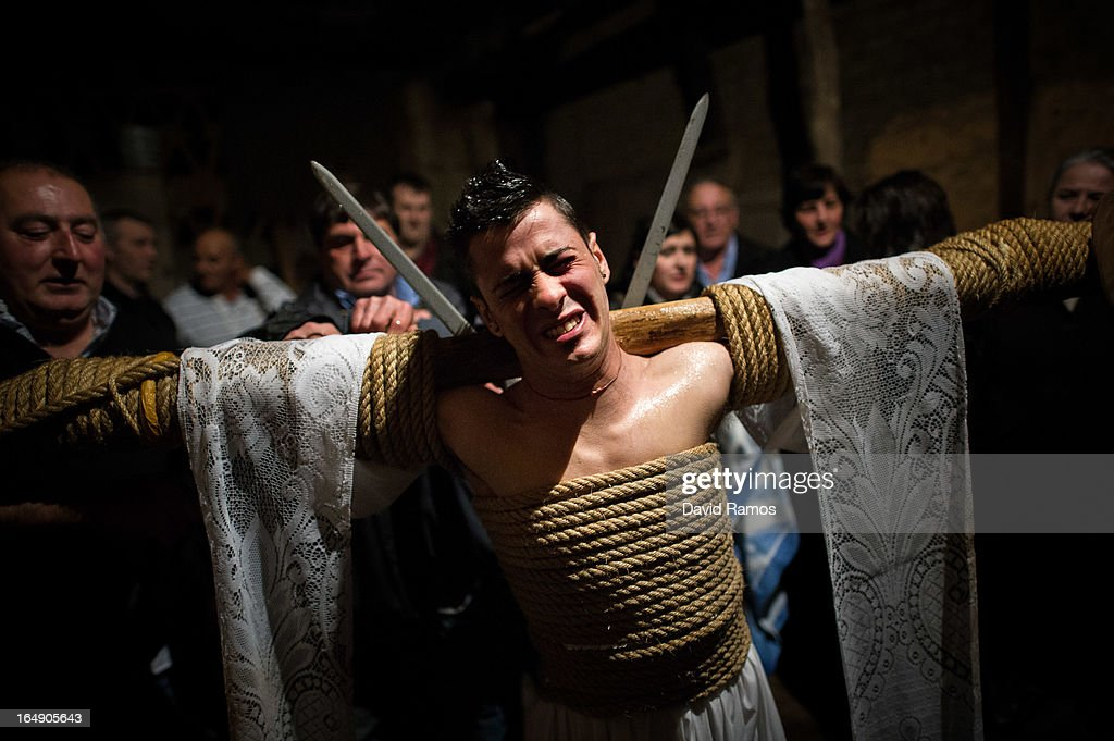 Cesar Higuero Martin, aged 25, reacts after walking the way of the cross or 'Via Crucis' at the end of the procession of the 'Empalaos' on March 29, 2013 in Valverde de la Vera, Spain. Empalaos make the steps of the 'Via Crucis', marking the Stations of the Cross, during the night of Maundy Thursday while bound by rope to a crucifix as an act of penance and to honour a promise made to the Empalaos Brotherhood and the Christ of Vera Cruz, in the town of Valverde de la Vera. The process of dressing the Empalao in the traditional costume is taken with great care, with the family and dressers paying attention to ensure that no harm is caused to the penitent and that they are aided in their recovery, including being massaged and rubbed with rosemary alcohol. Many Spanish towns and villages retain such rites and religious traditions, many passed down from medieval times, across the Easter weekend.