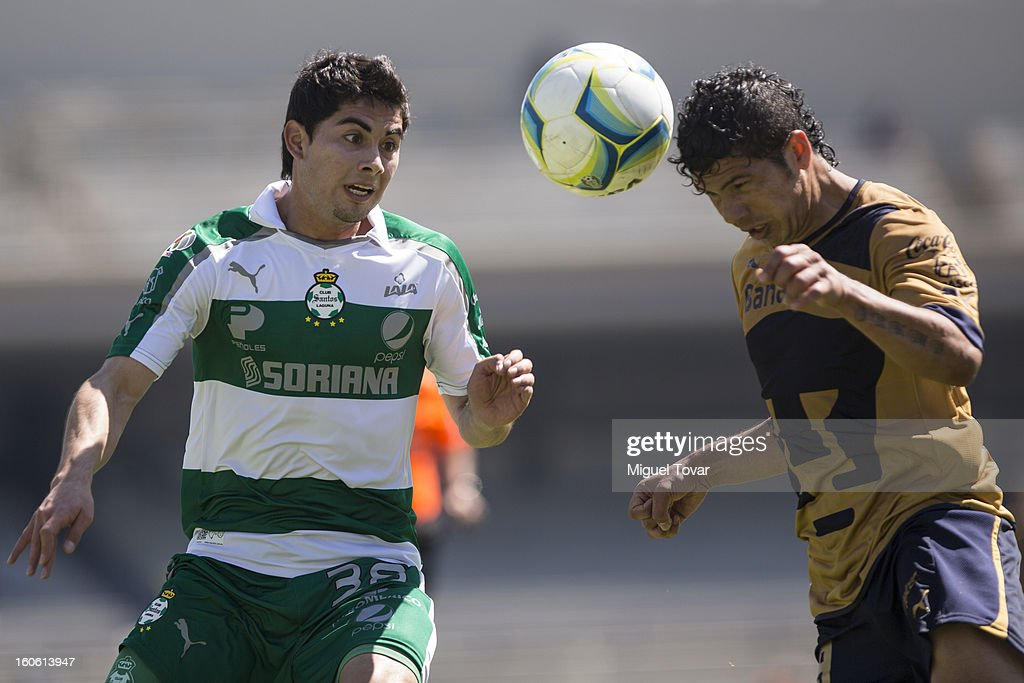 Cesar Ibañez (R) of Santos struggles for the ball with Robin Ramirez (L) of Pumas during a match between Pumas and Santos as part of the Clausura 2013 at Olímpico Stadium on February 03, 2013 in Mexico City, Mexico.