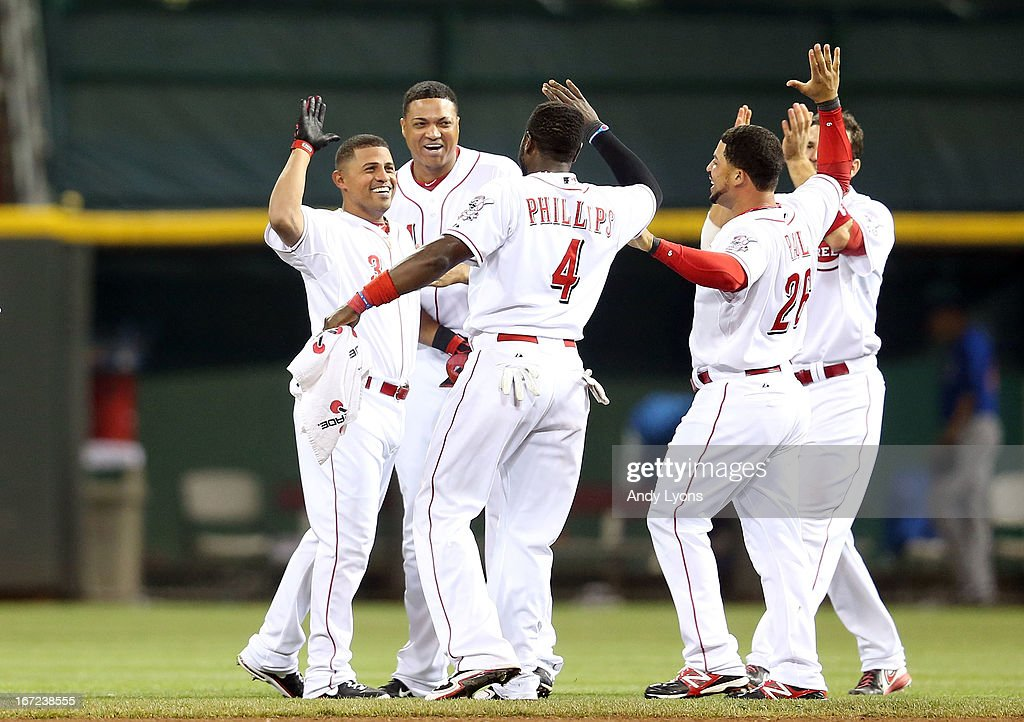 <a gi-track='captionPersonalityLinkClicked' href=/galleries/search?phrase=Cesar+Izturis&family=editorial&specificpeople=203148 ng-click='$event.stopPropagation()'>Cesar Izturis</a> #3 of the Cincinnati Reds celebrates with teammates after Izturis hit the game winning single in the 13th inning to beat the Chicago Cubs 5-4 at Great American Ball Park on April 22, 2013 in Cincinnati, Ohio.
