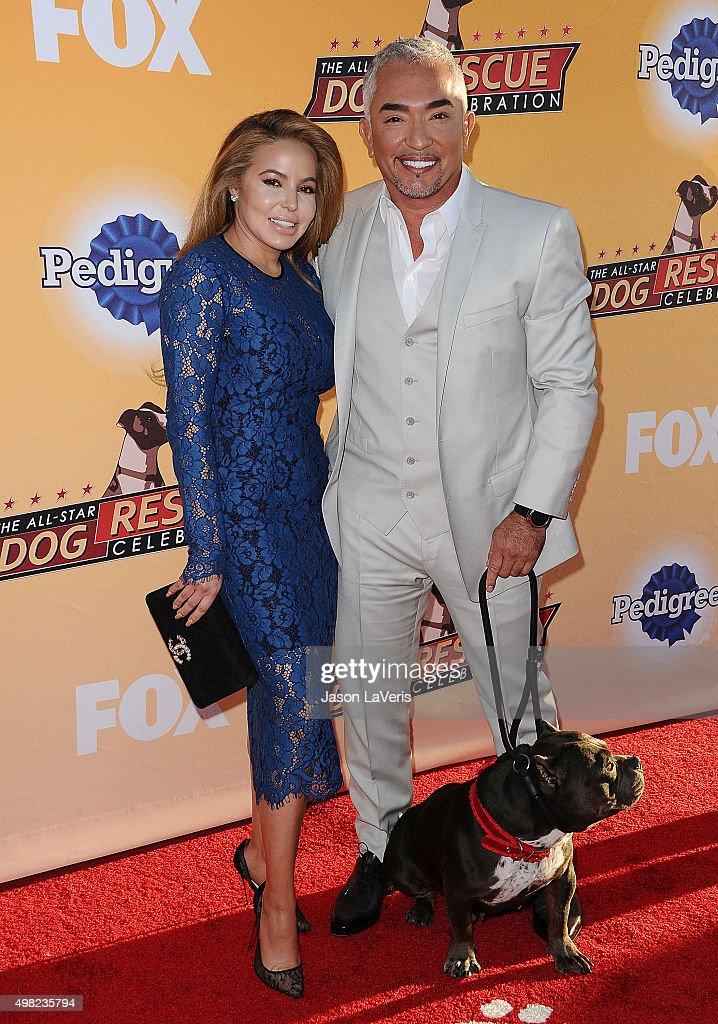Cesar Millan and wife Jahira Dar attend the AllStar Dog Rescue Celebration at Barker Hangar on November 21 2015 in Santa Monica California