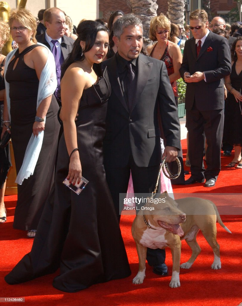 Cesar Millan with guest during 58th Annual Creative Arts Emmy Awards Arrivals at Shrine Auditorium in Los Angeles California United States