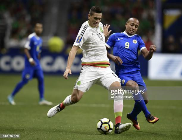 Cesar Montes of Mexico and Gino van Kessel of Curacao vie for the ball during their CONCACAF Gold Cup soccer match at the Alamodome on July 16 2017...