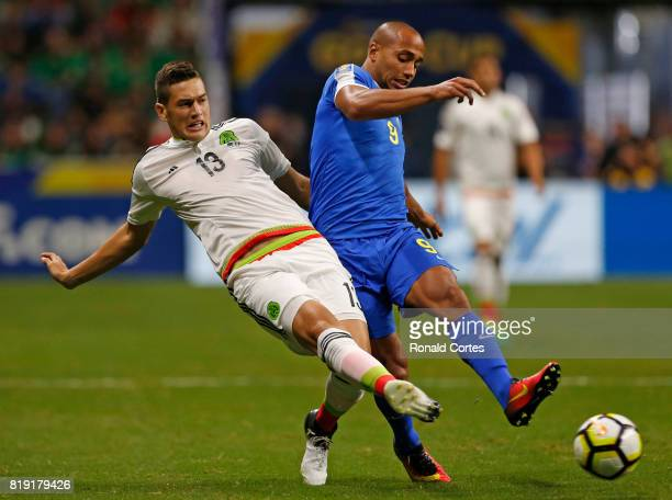 Cesar Montes of Mexico attempts to take the ball away from Gino Van Kessel of Curacao in the first half during the 2017 CONCACAF Gold Cup at...