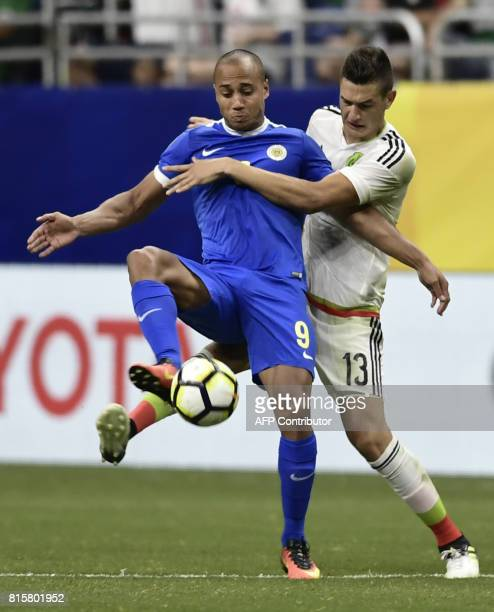 Cesar Montes of Mexico grapples with Gino van Kessel of Curacao during their CONCACAF Gold Cup soccer match on July 16 2017 at the Alamodome in San...