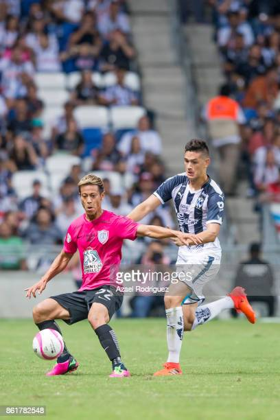 Cesar Montes of Monterrey fights for the ball with Keisuke Honda of Pachuca during the 13th round match between Monterrey and Pachuca as part of the...