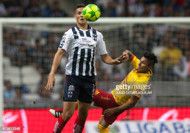 Cesar Montes of Monterrey vies for the ball with Raúl Ruidiaz of Morelia during the Mexican Clausura 2017 tournament football match at the BBVA...