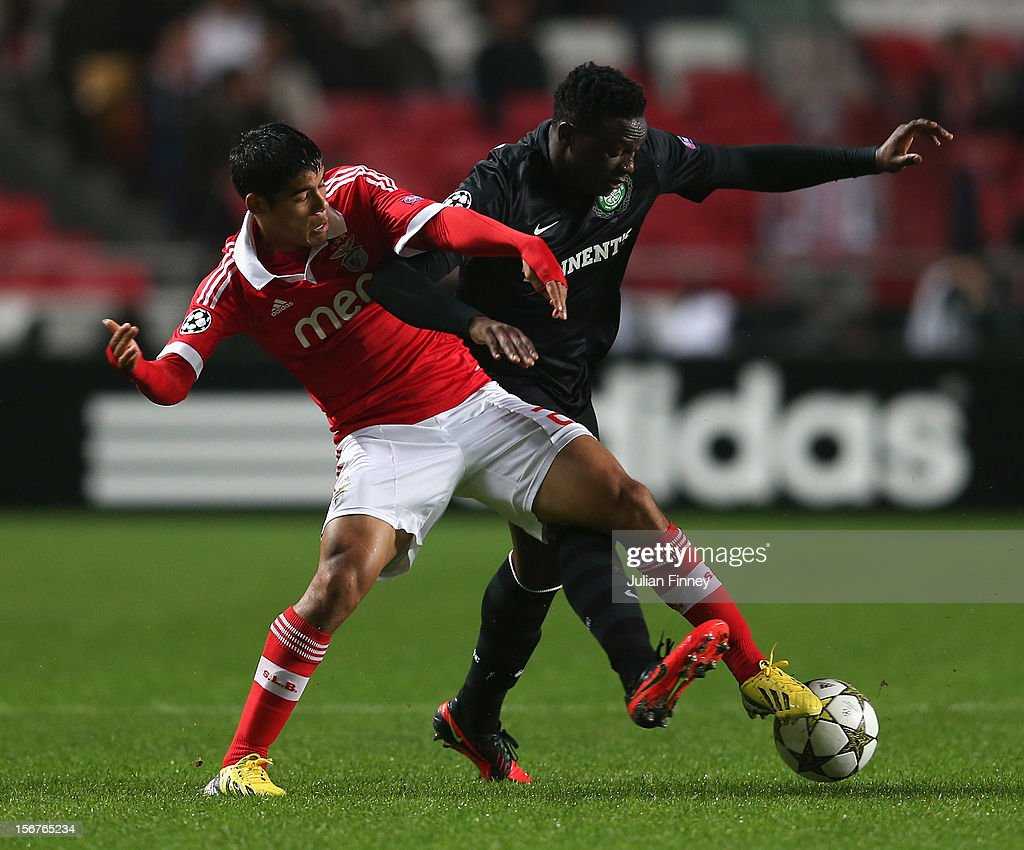 Cesar Peixoto of Benfica battles with Victor Wanyama of Celtic during the UEFA Champions League, Group G match between SL Benfica and Celtic FC at Estadio da Luz on November 20, 2012 in Lisbon, Portugal.