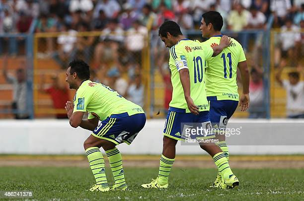 Cesar Pereyra of Sporting Cristal celebrates with his teammates after scoring the second goal of his team against Union Comercio during a match...