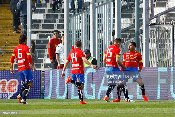 Cesar Pinares of Union Espanola celebrates with teammates after scoring the first goal of his team during a match between Colo Colo and Union...