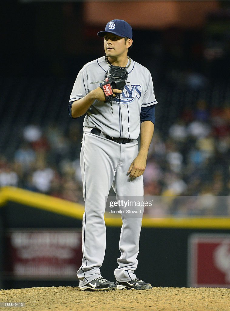 Cesar Ramos #27 of the Tampa Bay Rays pitches against the Arizona Diamondbacks Tampa Bay Rays in the eighth inning at Chase Field on August 6, 2013 in Phoenix, Arizona. The Diamondbacks defeated the Rays 6-1.