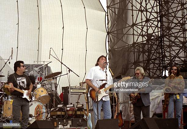 Cesar Rosas and David Hidalgo of Los Lobos perform with Jerry Garcia of the Grateful Dead at Laguna Seca Raceway on August 1 1988 in Monterey...