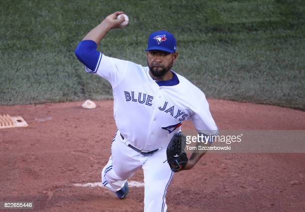 Cesar Valdez of the Toronto Blue Jays delivers a pitch in the first inning during MLB game action against the Oakland Athletics at Rogers Centre on...