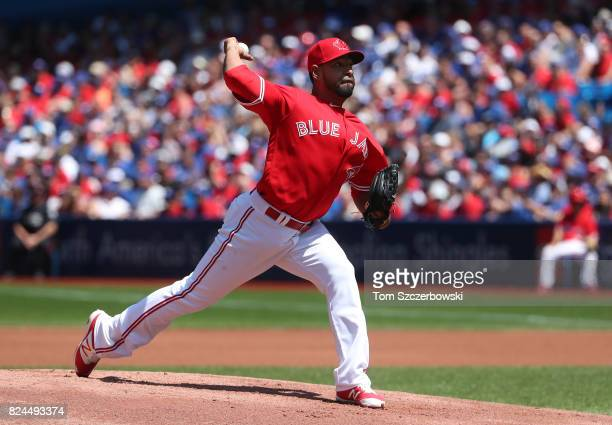 Cesar Valdez of the Toronto Blue Jays delivers a pitch in the first inning during MLB game action against the Los Angeles Angels of Anaheim at Rogers...