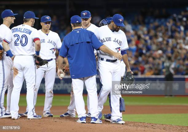 Cesar Valdez of the Toronto Blue Jays exits the game as he is relieved by manager John Gibbons in the seventh inning during MLB game action against...