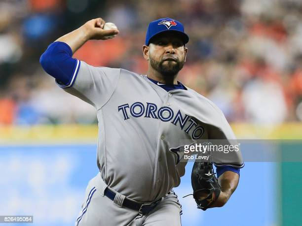 Cesar Valdez of the Toronto Blue Jays pitches in the first inning against the Houston Astros at Minute Maid Park on August 4 2017 in Houston Texas