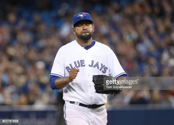 Cesar Valdez of the Toronto Blue Jays reacts after getting the last out of the sixth inning during MLB game action against the Oakland Athletics at...