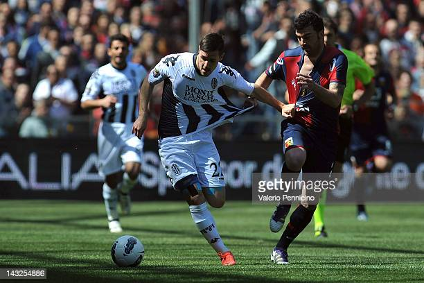 Cesare Bovo of Genoa CFC competes with Mattia Destro of AC Siena during the Serie A match between Genoa CFC and AC Siena at Stadio Luigi Ferraris on...