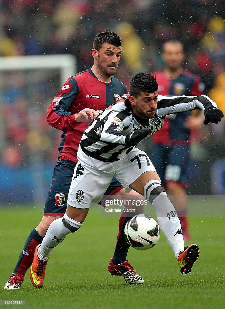 Cesare Bovo of Genoa CFC fights for the ball with Alessio Sestu of AC Siena during the Serie A match between Genoa CFC and AC Siena at Stadio Luigi Ferraris on March 30, 2013 in Genoa, Italy.