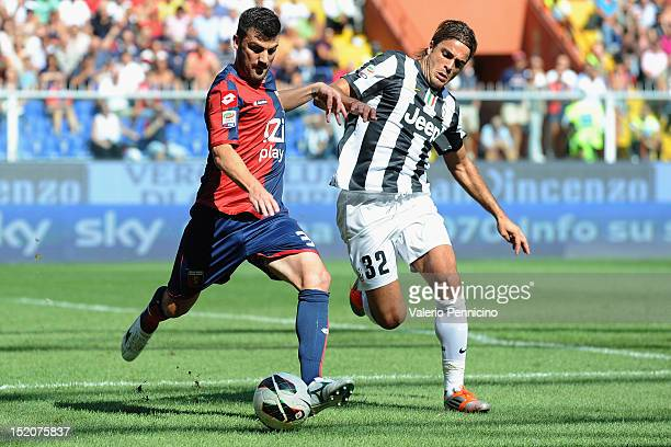 Cesare Bovo of Genoa CFC is challenged by Alessandro Matri of Juventus FC during the Serie A match between Genoa CFC and Juventus FC at Stadio Luigi...