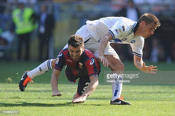 Cesare Bovo of Genoa clashes with German Gustavo Denis of Atalanta BC during the Serie A match between Genoa CFC and Atalanta BC at Stadio Luigi...