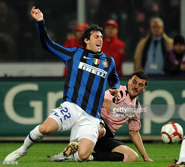 Cesare Bovo of Palermo tangles with Diego Milito of Internazionale Milano during the Serie A match between US Citta di Palermo and FC Internazionale...