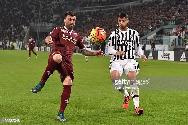Cesare Bovo of Torino FC in action against Alvaro Morata of Juventus FC during the Serie A match between Juventus FC and Torino FC at Juventus Arena...